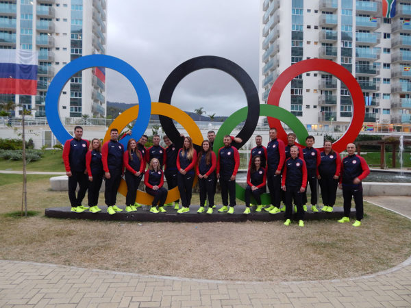 USA Shooting Team in front of the Olympic Rings